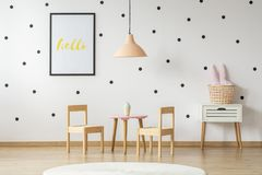 Scandinavian style cupboard and a wooden toy dining set in a cut stock photo