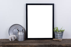 Scandinavian style empty photo frame mock up. Minimal home decor Stock Photography