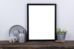 Scandinavian style empty photo frame mock up. Minimal home decor. Scandinavian style empty photo poster frame mock up. Minimal home decor on rustic wooden board stock photography