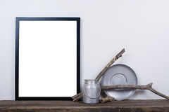 Scandinavian style empty photo frame mock up. Minimal home decor. Scandinavian style empty photo poster frame mock up. Minimal home decor on rustic wooden board Stock Photos