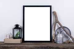 Scandinavian style empty photo frame mock up. Minimal home decor. Scandinavian style empty photo poster frame mock up. Minimal home decor on rustic wooden board stock photo