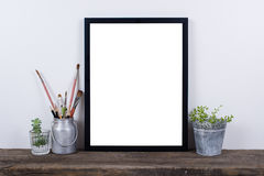 Scandinavian style empty photo frame mock up. Minimal home decor royalty free stock image
