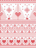 Scandinavian style inspired Christmas and festive winter seamless pattern in cross stitch style with Xmas trees , snowflakes. Rabbits, stars, hearts Royalty Free Stock Photography