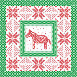 Scandinavian style and Nordic culture inspired Christmas and festive winter square pattern in cross stitch style with Swedish styl. E Dala horse, snowflake, star Stock Images