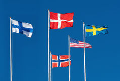 Scandinavian and US Flag. Scandinavian and The United States Flag on blue sky background Royalty Free Stock Photo