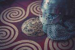 Scandinavian, viking helmet with chain mail on a red shield with Royalty Free Stock Image