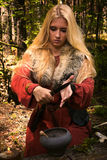 Scandinavian witch pythoness cooking potion Royalty Free Stock Photos