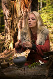 Scandinavian witch pythoness cooking potion Stock Photo