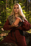 Scandinavian witch pythoness with runes Stock Images