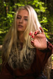 Scandinavian witch pythoness with runes Stock Image