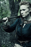 Scandinavian woman with sword Royalty Free Stock Photography