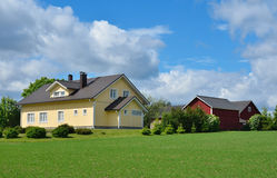 Country house in the weadow and farm buildings Royalty Free Stock Images