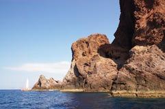 Scandola rocks and yacht Stock Image