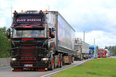 Scania Black Warrior in Truck Convoy Royalty Free Stock Images