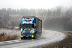 Scania 164L Semi Trucking on Foggy Winter Highway. SALO, FINLAND - DECEMBER 17, 2016: Customized Scania 164L 480 semi truck and curtainsider trailer of L. Retva Stock Photos