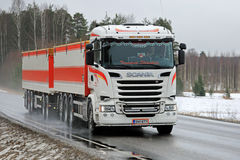 Scania R730 Combination Vehicle Trucking in Rain. SALO, FINLAND - MARCH 10, 2017: White customized Scania R730 combination vehicle of Transport Stromberg Stock Photos