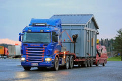 Scania R500 Hauls an Exceptional Load at Dusktime Stock Photo