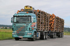 Scania R500 Logging Truck with Full Load. SALO, FINLAND - JULY 10, 2015: Scania R500 logging truck with log load. 2015 marks a substantial leap in forest Stock Photography