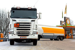 Scania R500 Tanker Truck Unloading Fuel at Petrol Station Stock Photography