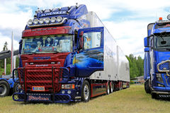 Scania R560 Truck and Full Trailer with Artwork. LOIMAA, FINLAND - JUNE 15, 2014:  Blue Scania R560 truck with artwork wins 2nd prize in the heavy trucks Royalty Free Stock Images