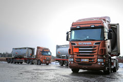 Scania R500 and Volvo FH Tank Trucks Haul Flammable Goods. SALO, FINLAND - JANUARY 17, 2015: Scania R500 and Volvo FH tank trucks haul flammable goods. The ADR Royalty Free Stock Photos