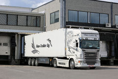 Scania Semi of Finn-Trailer Oy Unloads at Warehouse. SALO, FINLAND - JULY 10, 2016: White Scania R440 semi trailer truck of Finn-Trailer Oy unloads at a Royalty Free Stock Images