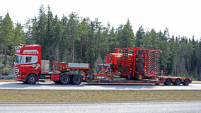 Scania Semi Hauls Agricultural Machinery in High Speed Royalty Free Stock Photos