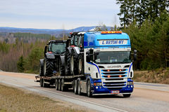 Scania Semi Trailer Hauls Farm Tractors royalty free stock images