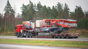 Scania Semi Truck Hauls Mobile Cone Crusher Royalty Free Stock Images