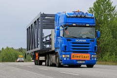 Scania Semi Truck Hauls a Wide Load Stock Photo