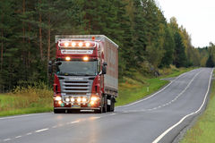 Scania Semi Trucking with Bright Headlights Royalty Free Stock Photography