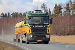 Scania Tank Truck Trucking. SALO, FINLAND - APRIL 1, 2016: Colorful Scania R500 tank truck for bulk transport trucking along rural highway. Scania celebrates 125 Stock Photos