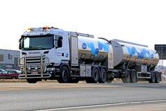 Scania Tanker Truck Transporting Milk. FORSSA, FINLAND - MARCH 1, 2014: Scania tanker truck is transporting Valio milk along highway No. 10 Stock Images