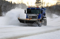 Scania Truck with Snowplow Clears Highway Stock Photos