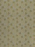 Scannen Sie das Vorsatzblatt eines alten Buches, gelb-grau-braun, mit dichtem und verwickeltem Blumenmuster Lizenzfreie Stockfotos