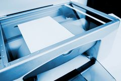 Scanner device working. Close-up working printer scanner copier device Royalty Free Stock Image