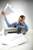 Scanner is out of order. Portrait of annoyed businessman holding printed papers Royalty Free Stock Photo