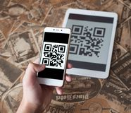 Scanning qr code from the tablet. Cashless purchase. Scanning barcode from the tablet. Cashless purchase Stock Photo
