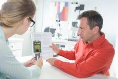 Scanning blood sample test tube Royalty Free Stock Photos