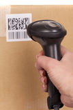 Scanning boxes. With  barcode scanner Royalty Free Stock Images