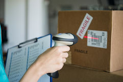 Scanning boxes with barcode scanner Royalty Free Stock Image