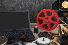 Scanning old 16 mm film with laptop. Scanning old 16 mm film with a laptop royalty free stock photos