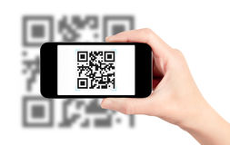Scanning QR Code With Mobile Phone. Scanning QR code with mobile smart phone. Isolated on white