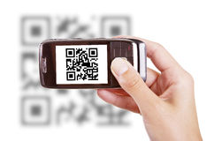 Scanning QR code with mobile phone Stock Image