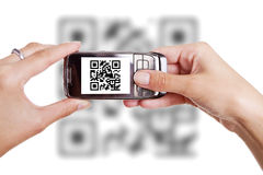Scanning QR code with mobile phone Royalty Free Stock Image
