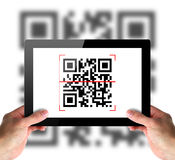 Scanning of QR code by tablet Stock Photos
