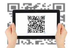 Scanning of QR code by tablet pc Stock Images
