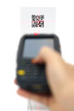 Scanning quick response code label  with laser.  Royalty Free Stock Images