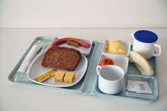 Scanty Food on a tablet like you can find in a canteen of hospital, university and similar places. stock photos