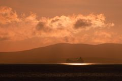 Scapa tanker. Oil tanker at anchor in Scapa Flow, Orkney in evening sunshine royalty free stock photography